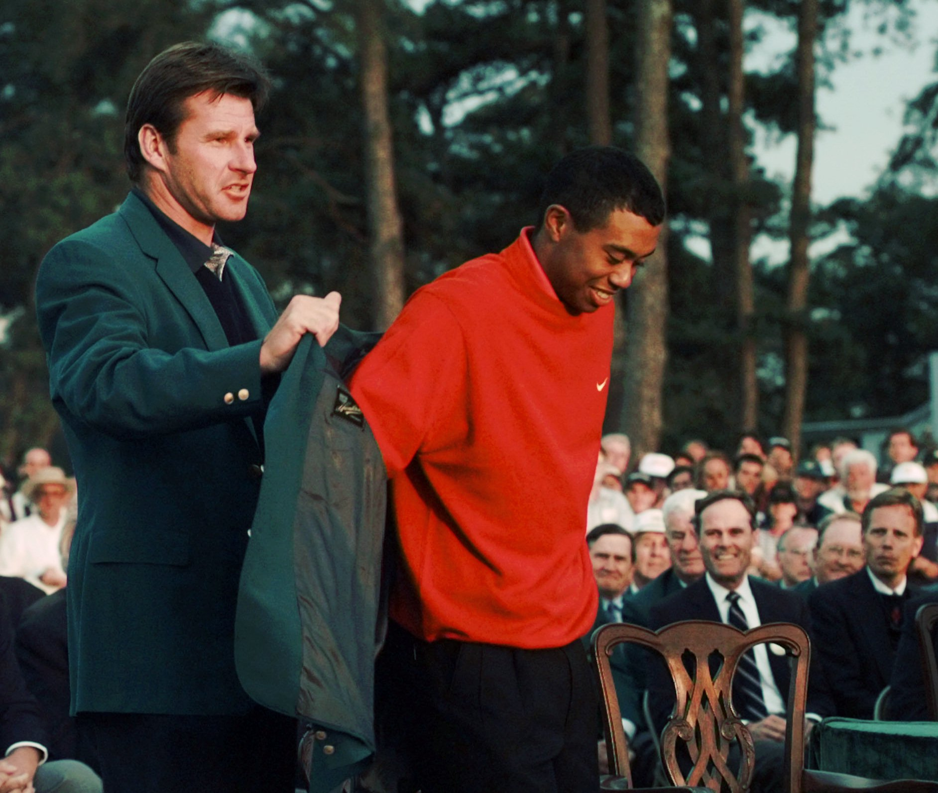 1997 Masters champion Tiger Woods receives his Green Jacket from last year's winner Nick Faldo, left, at the Augusta National Golf Club in Augusta, Ga., Sunday, April 13, 1997. (AP Photo/Amy Sancetta)