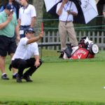 Patrick Reed lines up a putt for his partner.