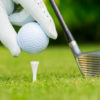 close-up-view-of-golf-ball-on-tee-on-golf-course-PT277JC