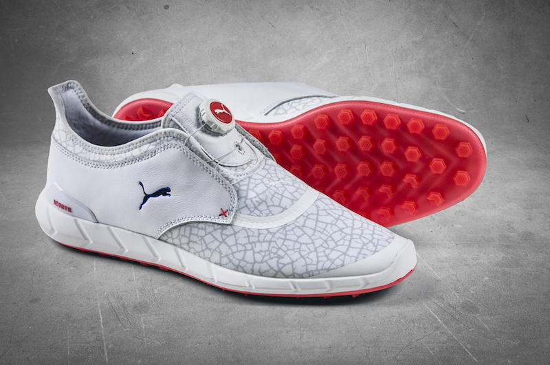 fead7f9174a The predominately white shoe with red and blue accents features a new  trendy graphic print and the PUMA s proprietary DISC laceless closure  system.